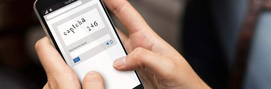Person holding phone with Captcha security feature