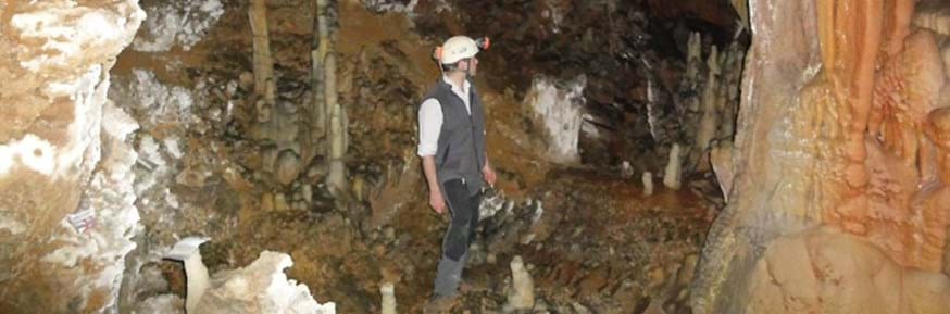 Researchers standing in a cavern