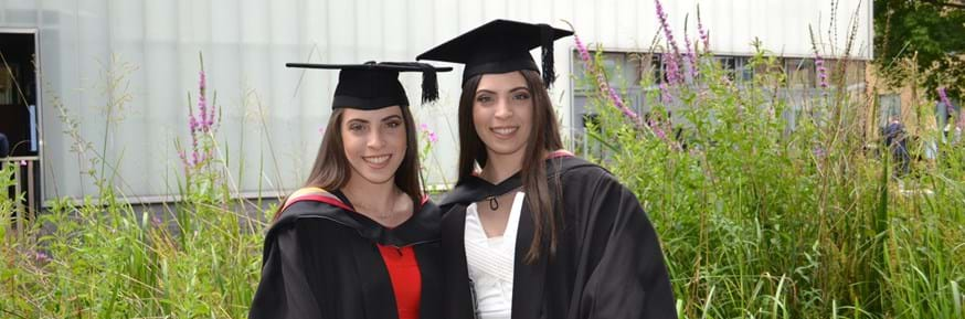 Identical twins Elpida and Rafaella Louca, who have graduated with a first-class degree in Mathematics
