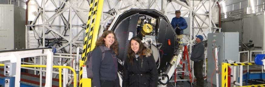 Veronica Ferreios Lopez and Dr Julie Wardlow at the back of the 10m primary mirror on the Keck 1 telescope.