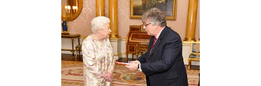 Professor Paul Muldoon receives the Queen's Gold Medal for poetry from Her Majesty the Queen