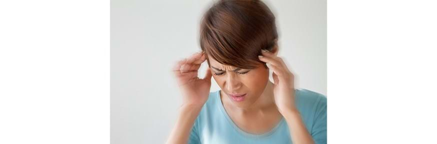 A woman having a migraine.