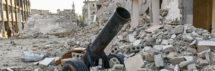 A mortar launcher in debris
