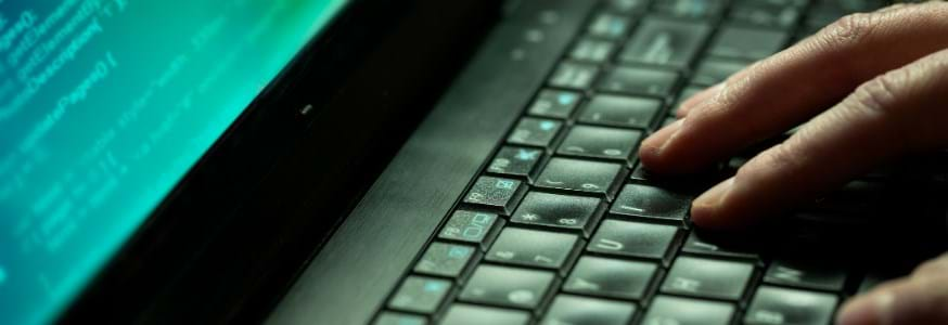 Fingers on a computer keyboard