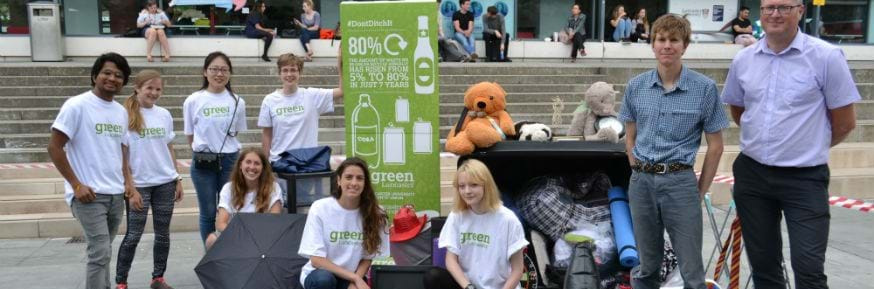 The Green Lancaster team with Mark Davies from Lancaster City Council (far right) pictured alongside an upturned bin and a variety of household goods and food that can be recycled