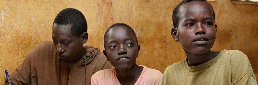 Three children studying in an Ethiopian school