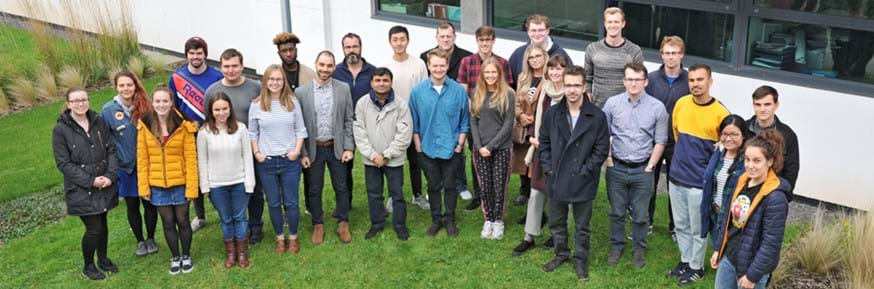 The cohort of enthusiastic researchers standing outside Lancaster Environment Centre