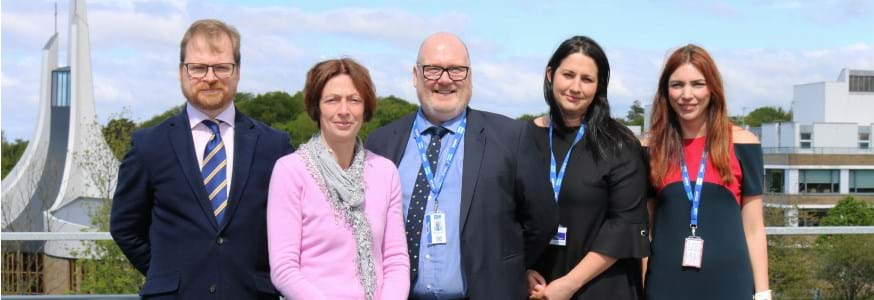 A picture of representatives of Lancaster University and Cardinal Newman College