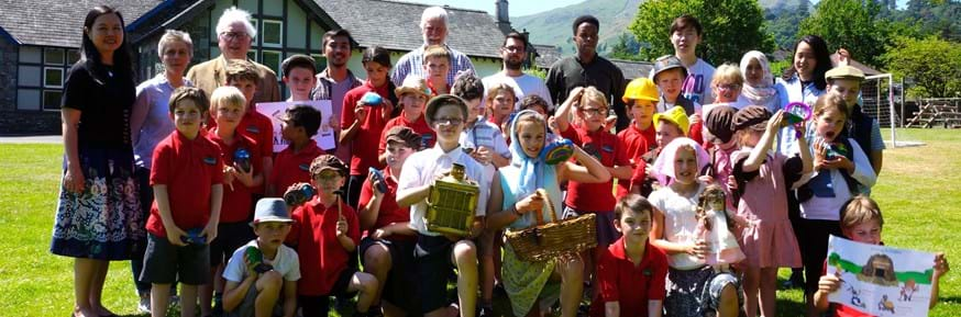 A group photograph of the pupils of Patterdale CofE Primary School with their teachers, and students and academics from Lancaster University Management School's Connected Communities Research lab