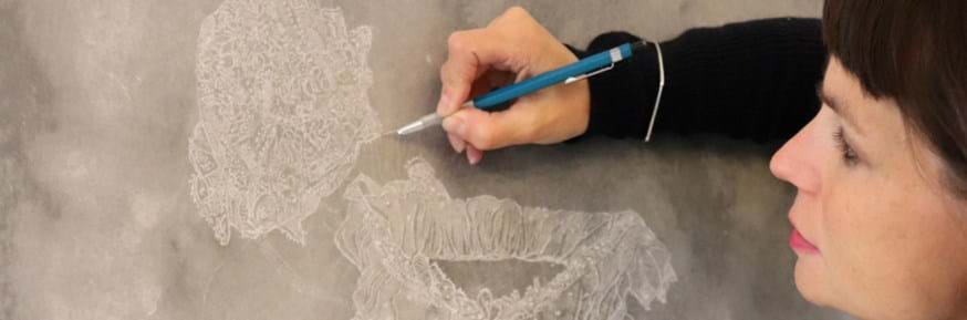 Dr Sarah Casey uses a needle pen to draw into wax to recreate the christening robe