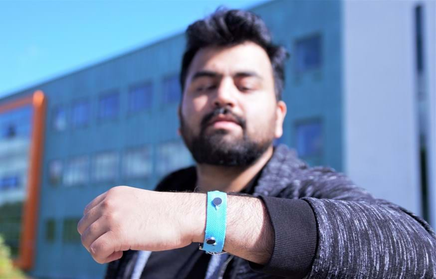 A man wearing a smart technology wrist band