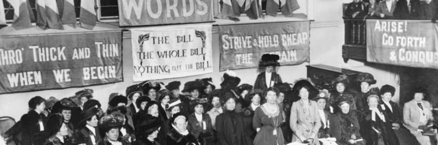 A suffragette meeting in Caxton Hall, Manchester, England circa 1908. Emmeline Pethick-Lawrence and Emmeline Pankhurst stand in the centre of the platform