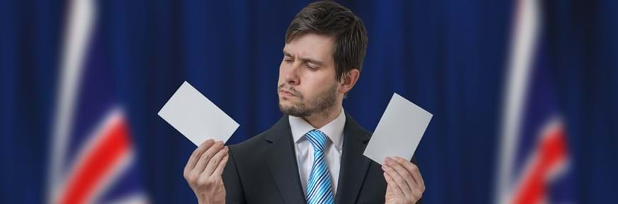 An undecided voter holding two ballots