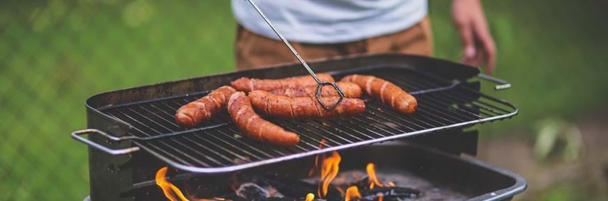 Sausages cooking on a barbecue