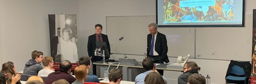 Dr Peter Collecott CMG presenting 'War and Diplomacy - some reflections on recent experience', introduced by CWD Deputy Director Dr Thomas Mills. Image by Meredith Guthrie.