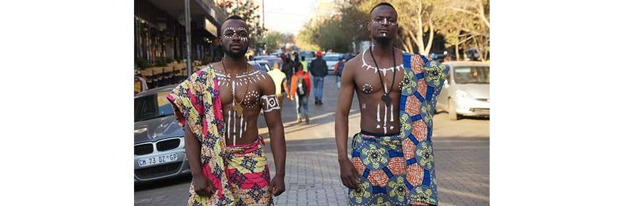 This photograph will be on show at an exhibition at Lancaster City Museum as part of the Festival: The picture shows traditional Congolese dress and colours, worn by a South African and a Congolese on the streets of the Johannesburg. The photo highlights the importance of unity.