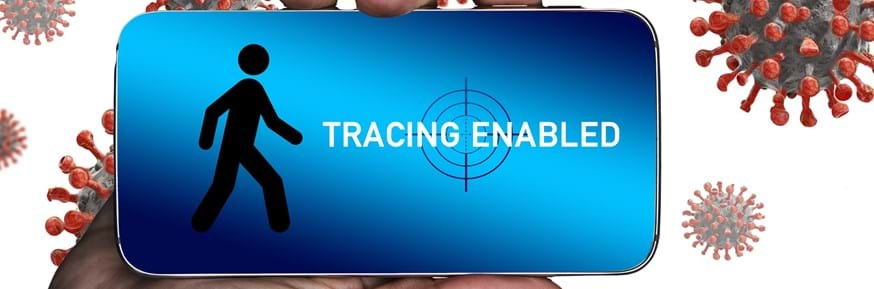 A hand holding a mobile phone with 'tracing enabled' displayed on the screen