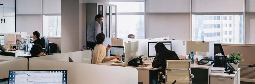 Picture of employees in an open-plan office