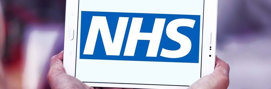 The NHS logo on a tablet screen