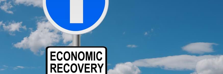 A road sign displaying 'Economic Recovery'