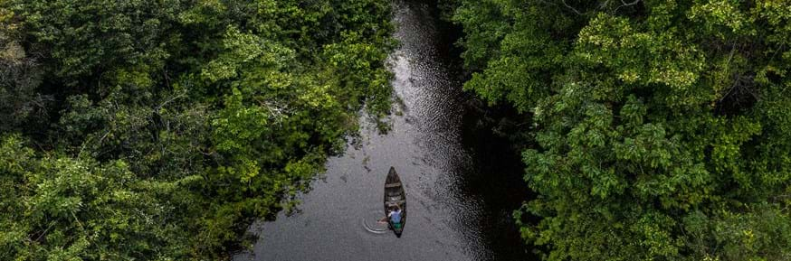 A canoe on a fresh water river in the Amazon