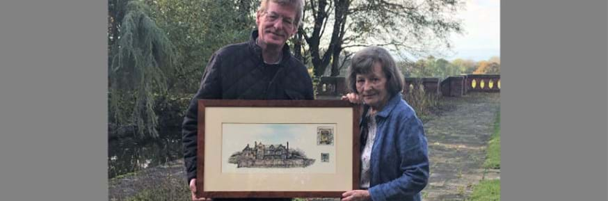 Greta and son Peter present the etching to the University
