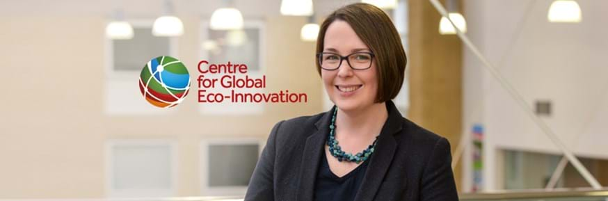 Professor Jessica Davies smiles to the camera inside Lancaster Environment Centre. The Centre for Global Eco-Innovation logo is shown to her left.