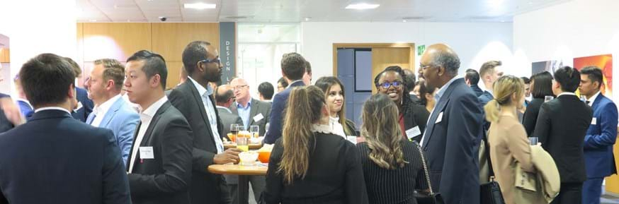 people talking in groups at the London Financial Networking event in London 2019.