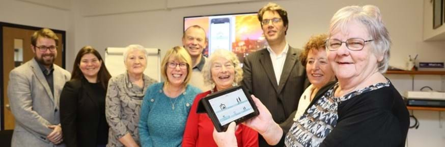 Lancaster University's Professor Niall Hayes, Dr Chris Bull and Dr Marcia Smith with a group of older residents who helped design the app