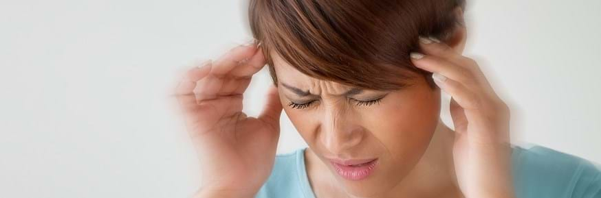 Woman suffering from migraine attack
