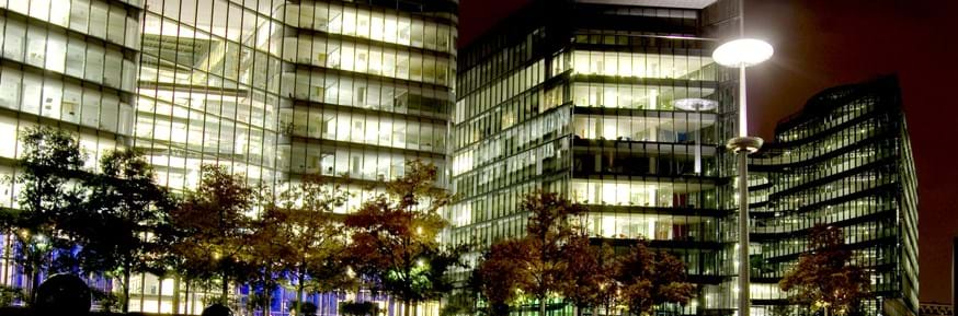 Office buildings with lights on at night