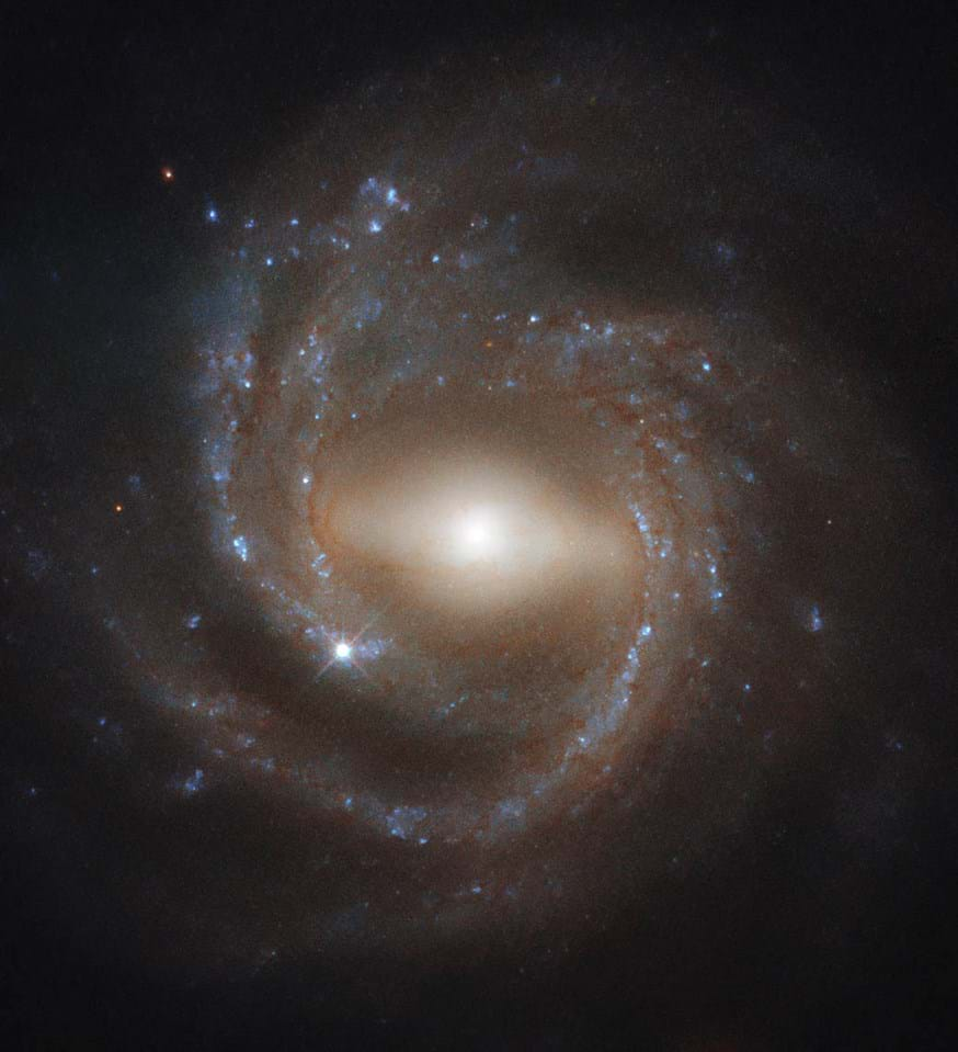 3, imaged by the Hubble Space Telescope's Wide Field Camera 3, is a barred spiral galaxy — like the Milky Way. Older spiral galaxies are more likely to have the bar across their center that's pictured here, suggesting bars indicate a galaxy's maturity.(Image: © ESA/Hubble & NASA, J. Walsh