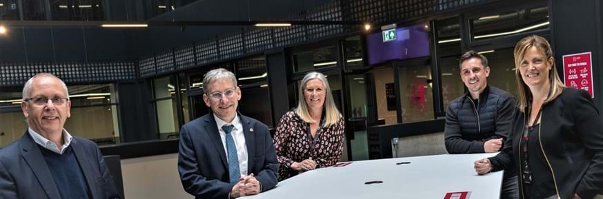 Sara (on the far right) joined by Gary Neville, Marnie Millard (Chair of Board), Professor Andy Schofield and Professor Steve Bradley