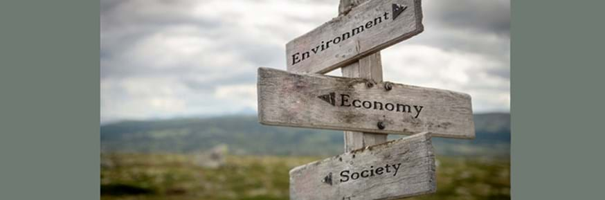 Signpost with Environment, Economy and Society listed
