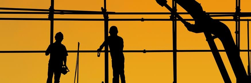 Silhouettes of construction workers.